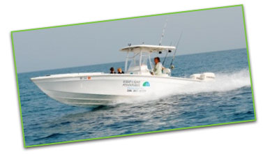 Photo of Captain Robert Thompson aboard the 25' Boston Whaler, Outrage, boat in the Great Exuma Islands, Bahamas